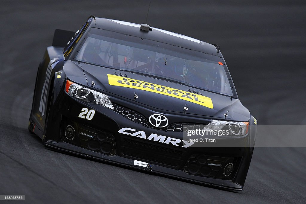 Matt Kenseth drives the #20 Dollar General Toyota during testing at Charlotte Motor Speedway on December 12, 2012 in Concord, North Carolina.