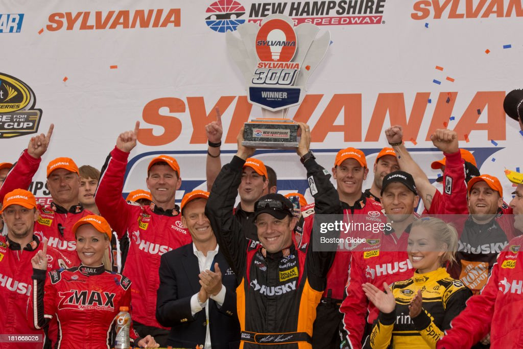 Matt Kenseth holds up the winner's trophy in Victory Lane. The NASCAR Sprint Cup series Sylvania 300 took place at the New Hampshire Motor Speedway, Sunday, Sept. 22, 2013.