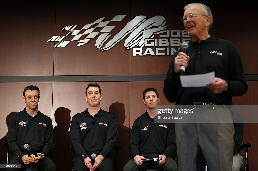 <a gi-track='captionPersonalityLinkClicked' href=/galleries/search?phrase=Matt+Kenseth&family=editorial&specificpeople=204192 ng-click='$event.stopPropagation()'>Matt Kenseth</a>, <a gi-track='captionPersonalityLinkClicked' href=/galleries/search?phrase=Kyle+Busch&family=editorial&specificpeople=211123 ng-click='$event.stopPropagation()'>Kyle Busch</a> and <a gi-track='captionPersonalityLinkClicked' href=/galleries/search?phrase=Denny+Hamlin&family=editorial&specificpeople=504674 ng-click='$event.stopPropagation()'>Denny Hamlin</a> listen as team owner <a gi-track='captionPersonalityLinkClicked' href=/galleries/search?phrase=Joe+Gibbs&family=editorial&specificpeople=171526 ng-click='$event.stopPropagation()'>Joe Gibbs</a> speaks to the media during the 2013 NASCAR Sprint Media Tour on January 24, 2013 in Concord, North Carolina.