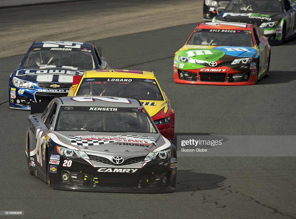 Matt Kenseth, the eventual winner in turn one, in front of Joey Logano, Jimmie Johnson, and Kyle Busch. The NASCAR Sprint Cup series Sylvania 300 took place at the New Hampshire Motor Speedway, Sunday, Sept. 22, 2013.