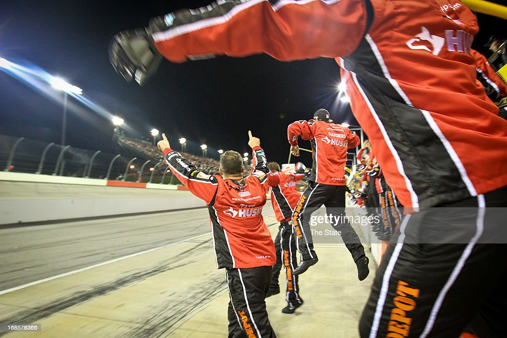 Matt Kenseth's pit crew erupts as Kenseth crosses the finish line to win the Southern 500 at Darlington Raceway in Darlington, South Carolina, on Saturday, May 11, 2013.