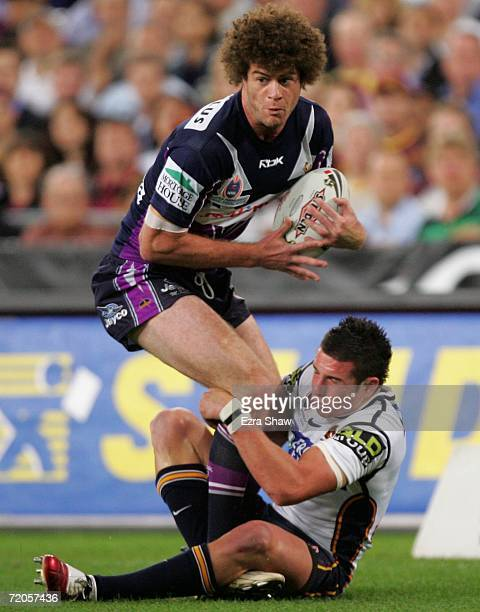 Matt King of the Storm is tackled by Darius Boyd of the Broncos during the NRL Grand Final match between the Brisbane Broncos and the Melbourne Storm...