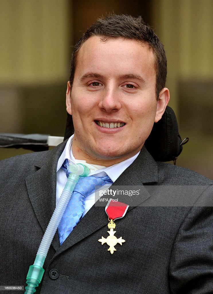 Matt King proudly wears his Order of the British Empire (OBE) medal, after it was presented to him by the Prince of Wales during the Investiture ceremony at Buckingham Palace on January 25, 2013 in London, England.