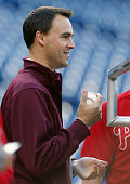 Matt Klentak Vice President and General Manager of the Philadelphia Phillies looks on from behind the batting cage before the start of an MLB game...