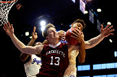 Matt Klinewski of the Lafayette Leopards battles Kelly Oubre Jr #12 and Cliff Alexander of the Kansas Jayhawks for a rebound during the game at Allen...