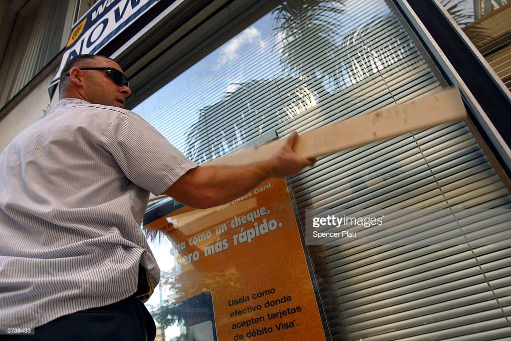 Matt Klotz boards up a store on the first day of the 2003 round of ministerial negotiations for the Free Trade Area of the Americas (FTAA) November 17, 2003 in Miami, Florida. Due to expected protests from anarchists, labor groups and globalization foes, much of the city of Miami is in a police lockdown with thousands of stores boarded-up and closed.