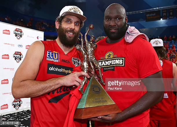 Matt Knight and Nate Jawai of the Wildcats pose with the trophy after winning the Championship during game three of the NBL Grand Final series...