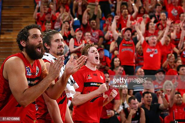Matt Knight Greg Hire and Rhys Vague of the Wildcats celebrate a basket during game three of the NBL Grand Final series between the Perth Wildcats...