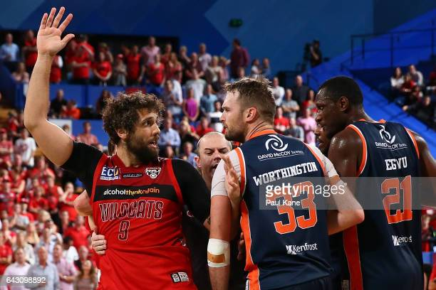 Matt Knight of the Wildcats and Mark Worthington of the Taipans exchange words during the game two NBL Semi Final match between the Perth Wildcats...