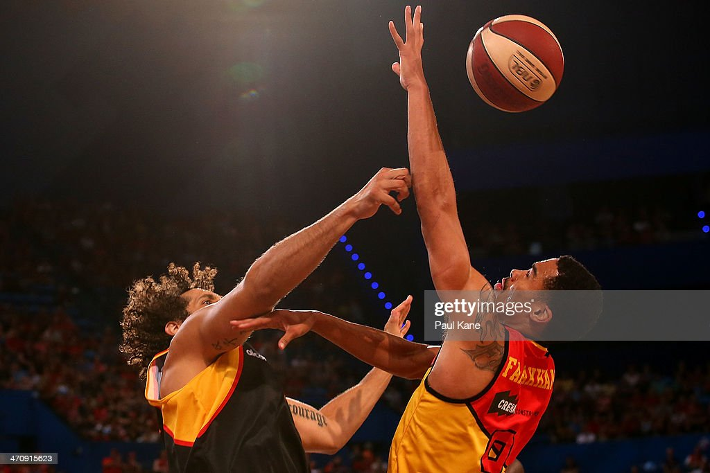 Matt Knight of the Wildcats blocks a shot by Mustapha Farrakhan of the Tigers during the round 19 NBL match between the Perth Wildcats and the Melbourne Tigers at Perth Arena on February 21, 2014 in Perth, Australia.