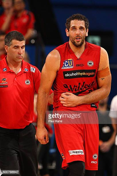 Matt Knight of the Wildcats comes from the court with an injury during the round 10 NBL match between the Perth Wildcats and Melbourne United at...
