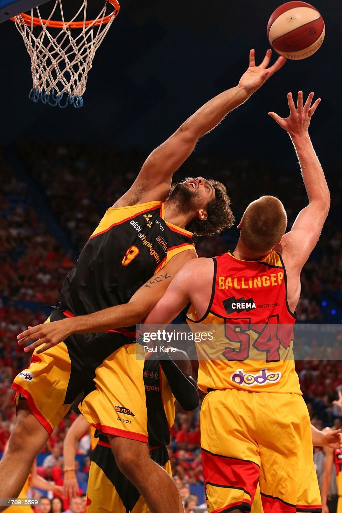 Matt Knight of the Wildcats contests a rebound against Adam Ballinger of the Tigers during the round 19 NBL match between the Perth Wildcats and the Melbourne Tigers at Perth Arena on February 21, 2014 in Perth, Australia.