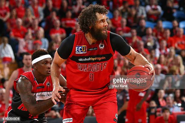 Matt Knight of the Wildcats controls the ball against Marvelle Harris of the Hawks during the round three NBL match between the Perth Wildcats and...