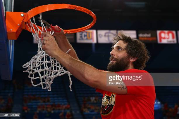 Matt Knight of the Wildcats cuts the net after winning the NBL Grand Final series between the Perth Wildcats and the Illawarra Hawks at Perth Arena...