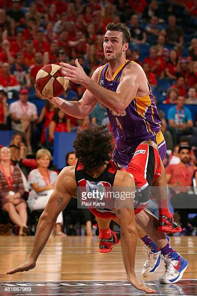 Matt Knight of the Wildcats gets fouled by AJ Ogilvy of the Kings during the round seven NBL match between the Perth Wildcats and the Sydney Kings at...