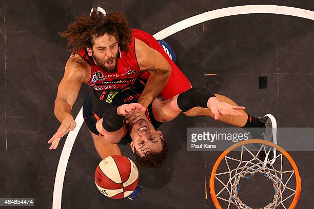 Matt Knight of the Wildcats goes to the basket against Alex Loughton of the Taipans during game two of the NBL Finals series between the Perth...
