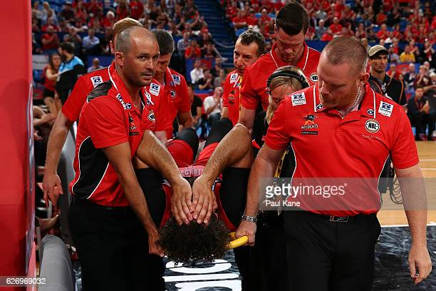 Matt Knight of the Wildcats is taken from the court on a stretcher after taking a charge from Cam Bairstow of the Bullets during the round nine NBL...