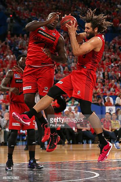 Matt Knight of the Wildcats pulls down a rebound against Nate Jawai during the round two NBL match between the Perth Wildcats and the New Zealand...