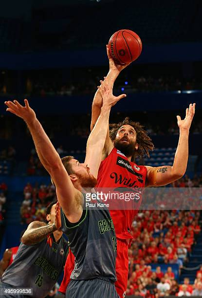 Matt Knight of the Wildcats puts the ball up against Brian Conkin of the Crocodiles during the round five NBL match between Perth Wildcats and...