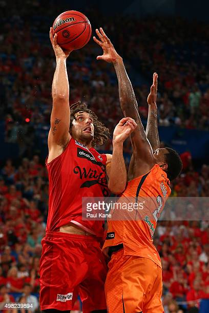 Matt Knight of the Wildcats puts up a shot against Torrey Craig of the Taipans during the round seven NBL match between the Perth Wildcats and the...