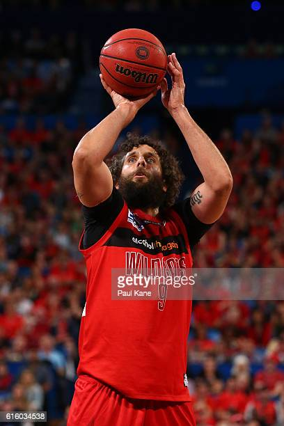 Matt Knight of the Wildcats shoots a free throw during the round three NBL match between the Perth Wildcats and the Illawarra Hawks at Perth Arena on...
