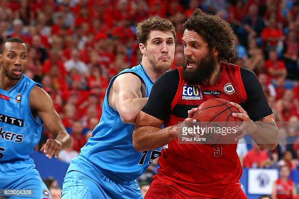 Matt Knight of the Wildcats works to the basket against Robert Loe of the Breakers during the round six NBL match between the Perth Wildcats and the...