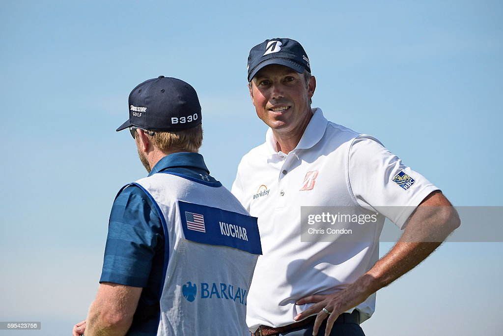 Matt Kuchar and caddie John Wood wait on the 11th green during the first round of The Barclays at Bethpage State Park on August 25 2016 in...