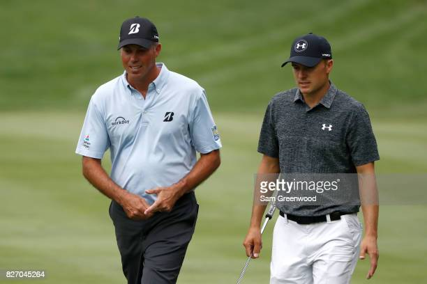 Matt Kuchar and Jordan Spieth walk up the fairway during the final round of the World Golf Championships Bridgestone Invitational at Firestone...