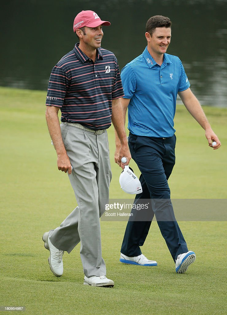 Matt Kuchar (L) and Justin Rose of England walk up a fairway during a practice round prior to the start of the TOUR Championship by Coca-Cola at East lake Golf Club on September 18, 2013 in Atlanta, Georgia.