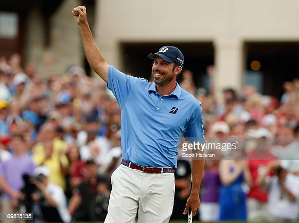 Matt Kuchar celebrates a birdie putt on the 18th green during the final round at the Memorial Tournament presented by Nationwide Insurance at...