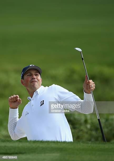 Matt Kuchar celebrates on the 18th green during the final round of the RBC Heritage at Harbour Town Golf Links on April 20 2014 in Hilton Head Island...