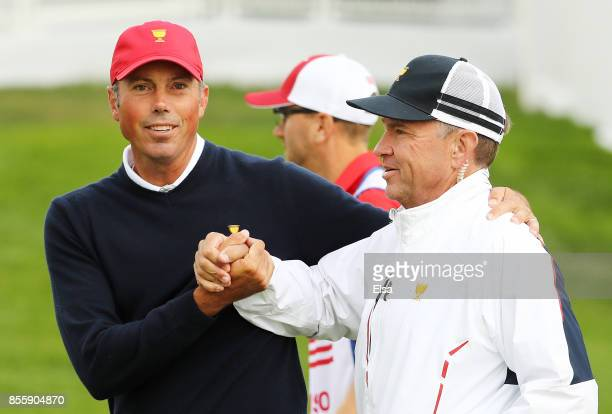 Matt Kuchar celebrates with Captain's assistant Davis Love III after Kuchar and Dustin Johnson of the US Team defeated Adam Hadwin of Canada and the...