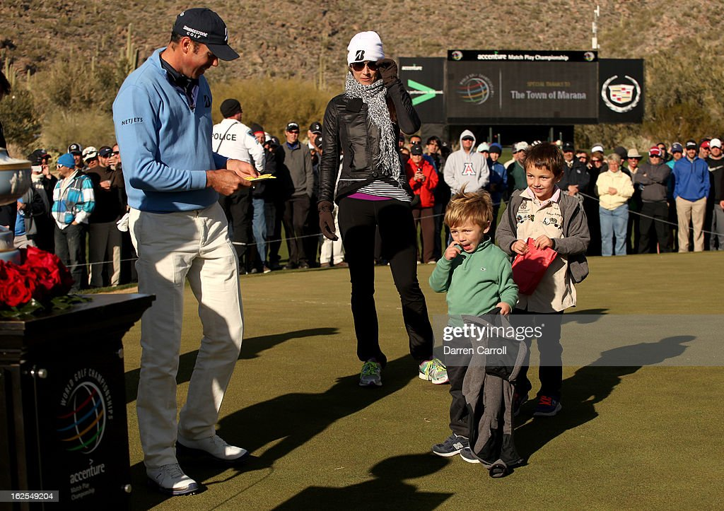 Matt Kuchar celebrates with his sons Carson and Cameron (R) and his wife Sybi after Kuchar won his championship match against Hunter Mahan 2 and 1 in 17 holes during the final round of the World Golf Championships - Accenture Match Play at the Golf Club at Dove Mountain on February 24, 2013 in Marana, Arizona.