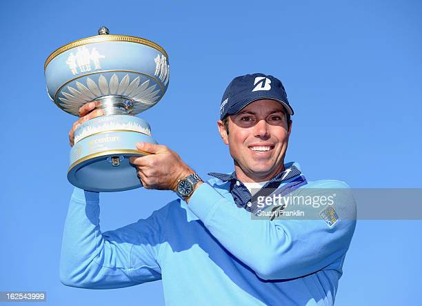 Matt Kuchar celebrates with the trophy after he won the championship match against Hunter Mahan during the final round of the World Golf...