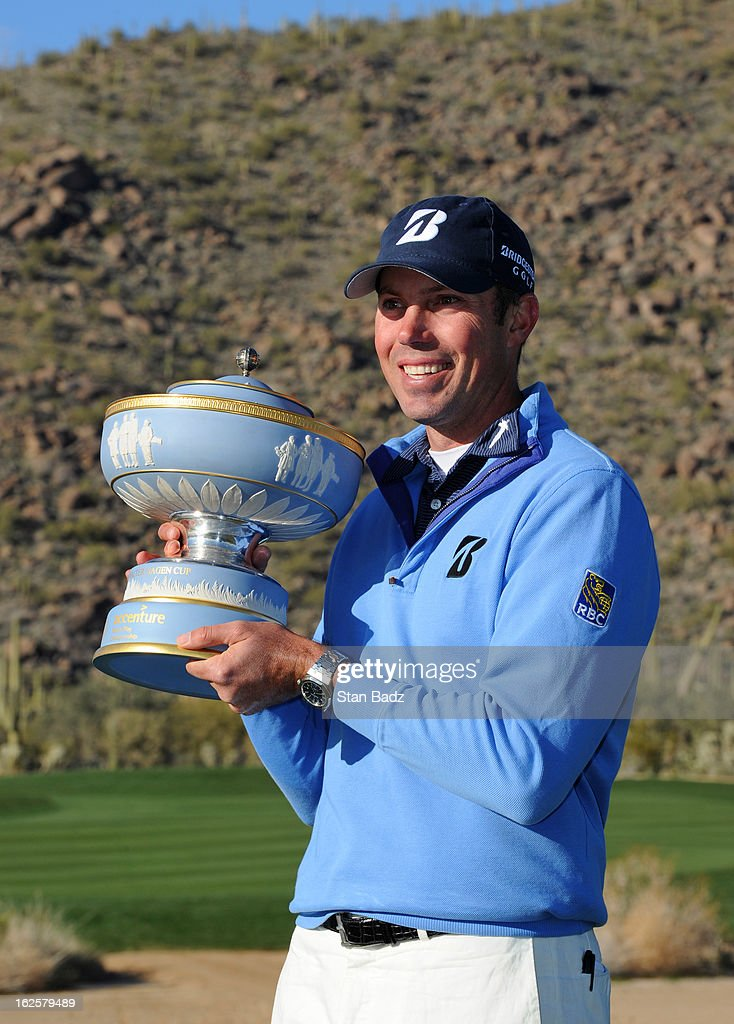 Matt Kuchar celebrates with the trophy after he won the championship match against Hunter Mahan during the final round of the World Golf Championships-Accenture Match Play Championship at The Golf Club at Dove Mountain on February 24, 2013 in Marana, Arizona.