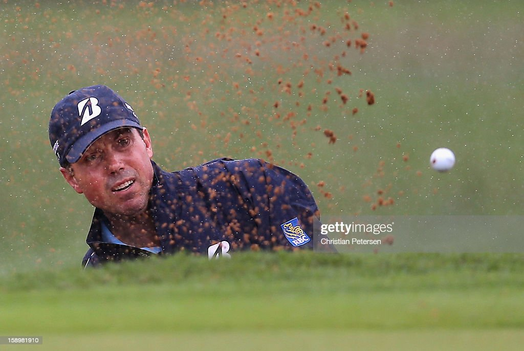 Matt Kuchar chips from the bunker onto the second hole green during the first round of the Hyundai Tournament of Champions at the Plantation Course on January 4, 2013 in Kapalua, Hawaii.
