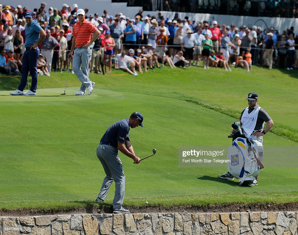 Matt Kuchar chips from the edge of the water on the 18th hole during the second round of the Dean & DeLuca Invitational Golf Tournament at the Colonial Country Club on Friday, May 27, 2016, in Fort Worth, Texas.