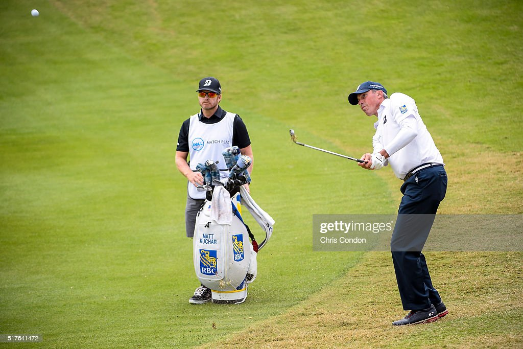 Matt Kuchar chips his second shot on the 18th hole as his caddie John Wood looks on during the fourth round of the World Golf Championships - Dell Match Play at Austin Country Club on March 26, 2016 in Austin, Texas.