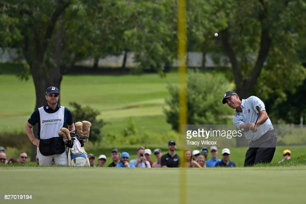Matt Kuchar chips up to the ninth green during the final round of the World Golf ChampionshipsBridgestone Invitational at Firestone Country Club on...