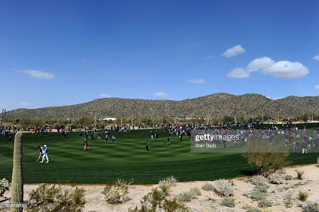 Matt Kuchar, far left, walks down the second fairway with the gallery following during the final round of the World Golf Championships-Accenture Match Play Championship at The Golf Club at Dove Mountain on February 24, 2013 in Marana, Arizona.