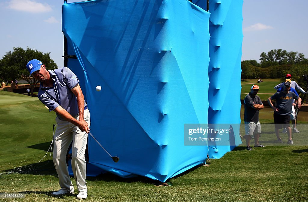 <a gi-track='captionPersonalityLinkClicked' href=/galleries/search?phrase=Matt+Kuchar&family=editorial&specificpeople=243226 ng-click='$event.stopPropagation()'>Matt Kuchar</a> hits a chip shot after taking a drop on the ninth hole during the second round of the 2013 HP Byron Nelson Championship at the TPC Four Seasons Resort on May 17, 2013 in Irving, Texas.