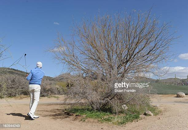 Matt Kuchar hits a shot from behind a tree on the ninth hole during the final round of the World Golf Championships Accenture Match Play at the Golf...