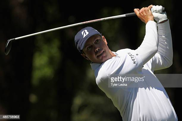Matt Kuchar hits a tee shot on the 11th hole during the final round of the RBC Heritage at Harbour Town Golf Links on April 20 2014 in Hilton Head...