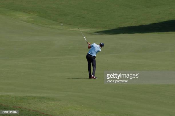 Matt Kuchar hits his approach shot on the 18th hole during the second round of the PGA Championship on August 11 2017 at Quail Hollow Club in...