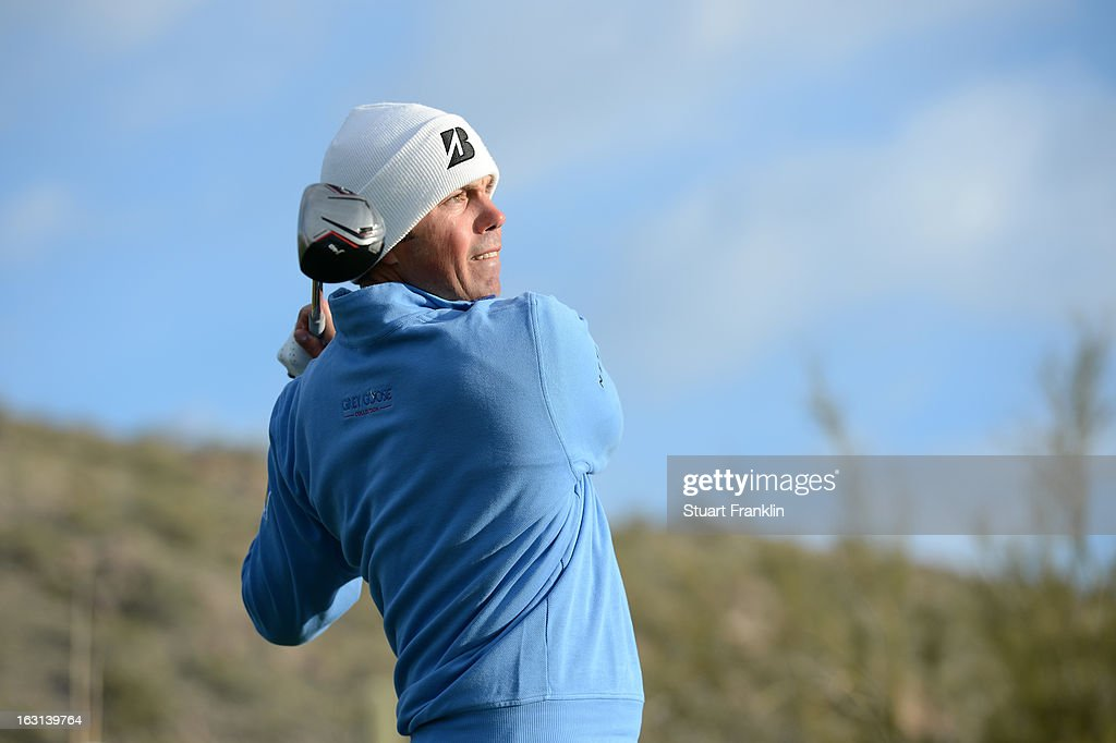 Matt Kuchar hits his tee shot during the semifinal round of the World Golf Championships - Accenture Match Play at the Golf Club at Dove Mountain on February 24, 2013 in Marana, Arizona.