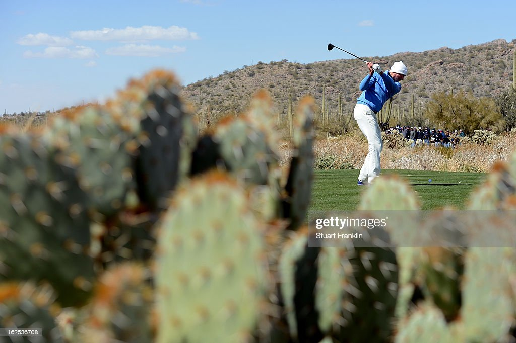 Matt Kuchar hits his tee shot on the ninth hole during the final round of the World Golf Championships - Accenture Match Play at the Golf Club at Dove Mountain on February 24, 2013 in Marana, Arizona.