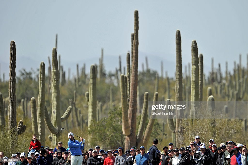 Matt Kuchar hits his tee shot on the sixth hole during the final round of the World Golf Championships - Accenture Match Play at the Golf Club at Dove Mountain on February 24, 2013 in Marana, Arizona.