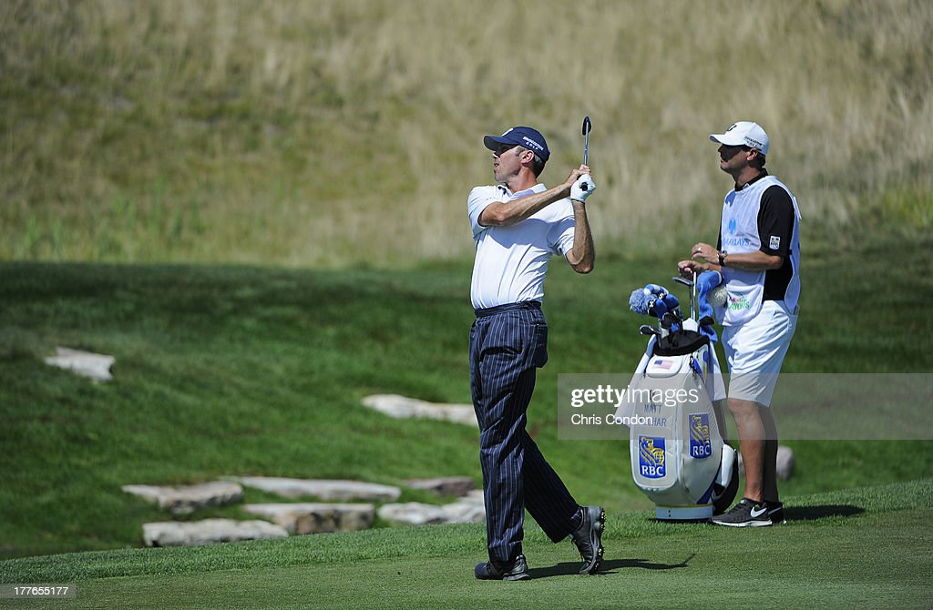 Matt Kuchar hits his third shot after taking a drop on the first hole during the final round of The Barclays at Liberty National Golf Club on August 25, 2013 in Jersey City, New Jersey.