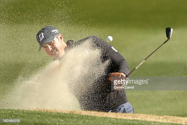 Matt Kuchar hits his third shot on the 11th hole out of the bunker during the quarterfinal round of the World Golf Championships Accenture Match Play...
