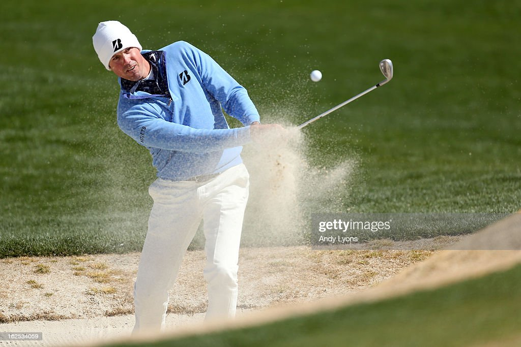 <a gi-track='captionPersonalityLinkClicked' href=/galleries/search?phrase=Matt+Kuchar&family=editorial&specificpeople=243226 ng-click='$event.stopPropagation()'>Matt Kuchar</a> hits his third shot on the fifth hole out of the bunker during the final round of the World Golf Championships - Accenture Match Play at the Golf Club at Dove Mountain on February 24, 2013 in Marana, Arizona.